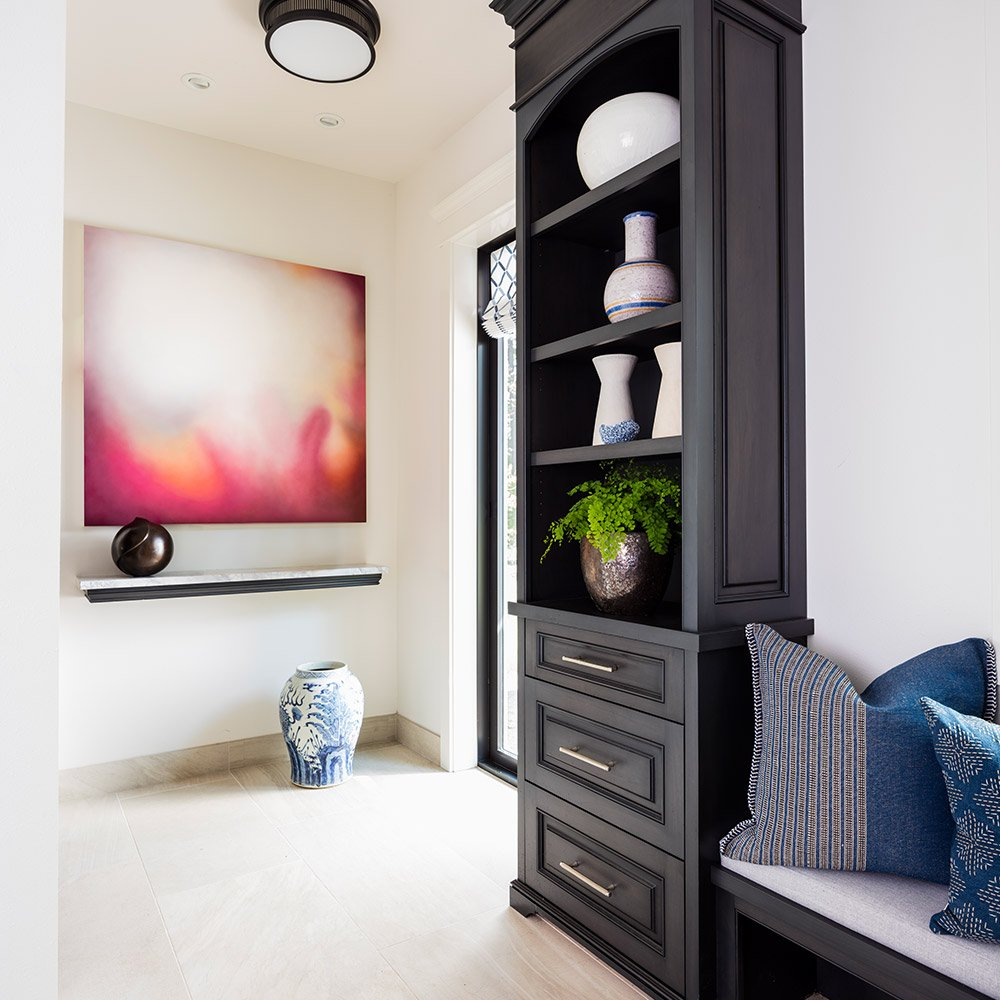 Black shelf with decorative vases; Dana Foster Interiors design