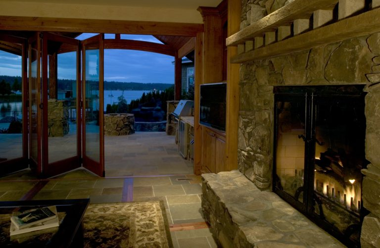 Stone fireplace and glass patio doors