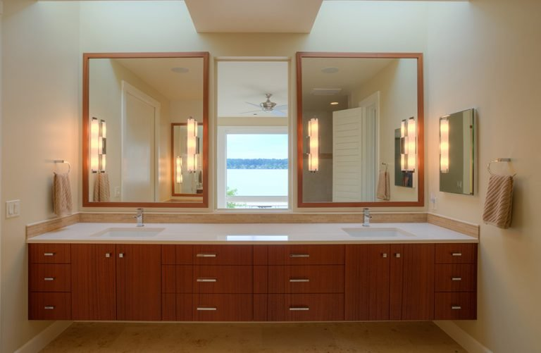 Bathroom with couples' sinks and mirrors