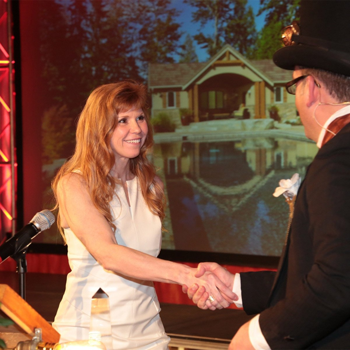 Dana Foster Interiors founder shaking hands at an award ceremony