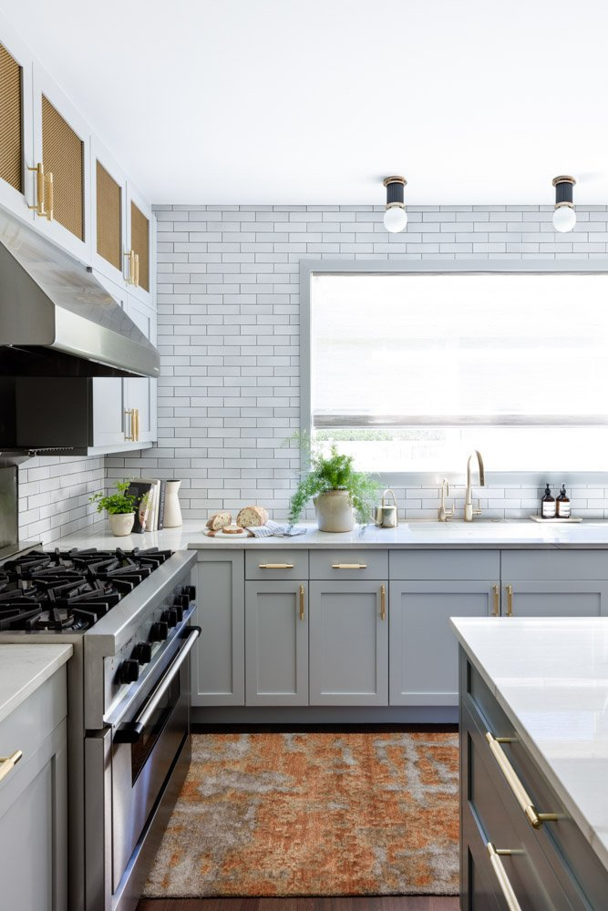 Stove and kitchen wall with tile backsplash