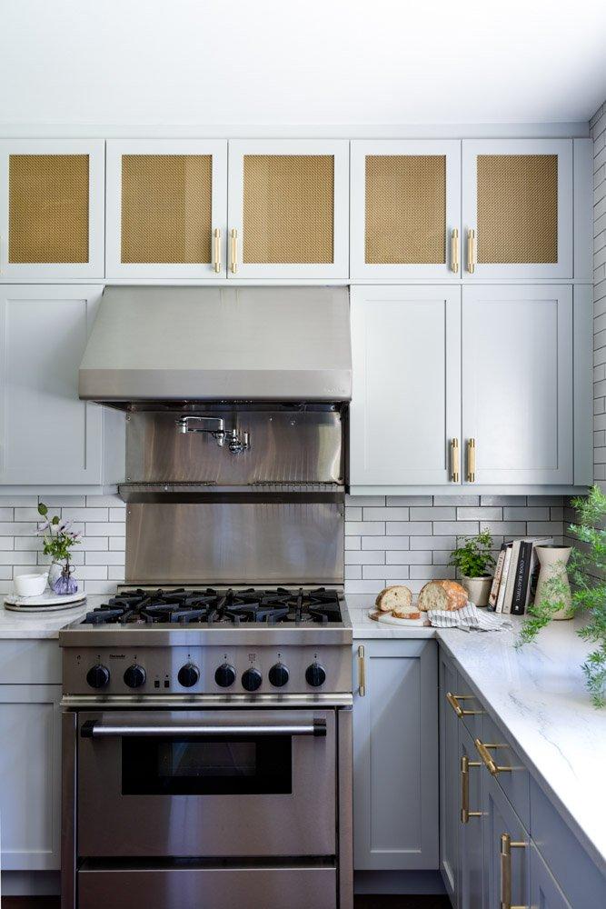 Stove, cupboards, and tile backsplash