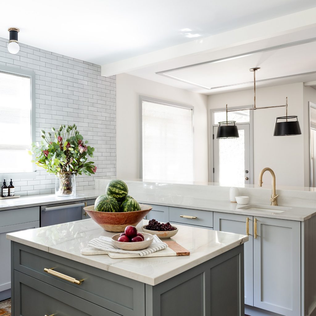 A modern kitchen with tile backsplash